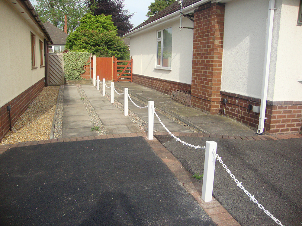 White Fence Post With White Chain and Diamond